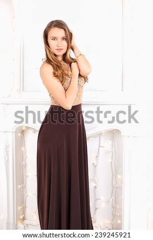 Close-up portrait of beautiful elegant young woman in gorgeous evening dress. - stock photo
