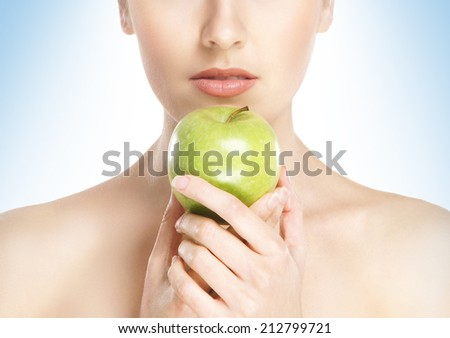Close-up portrait of beautiful, fresh, healthy and sensual girl eating apple isolated on white - stock photo