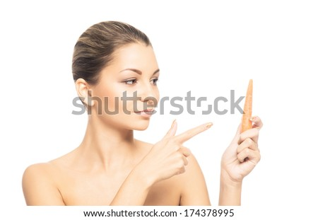 Close-up portrait of beautiful, fresh, healthy and sensual girl eating carrot isolated on white - stock photo