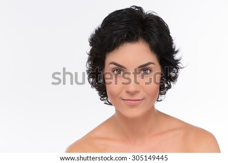 Close-up portrait of beautiful, fresh, healthy and sensual girl isolated on white. Mature woman smiling and looking with her eyes gimlet. - stock photo