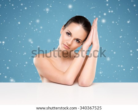 Close-up portrait of beautiful, fresh, healthy and sensual girl with a blank billboard - stock photo