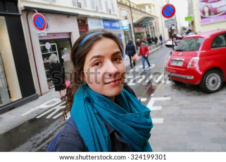 Close-up portrait of beautiful girl in Paris city