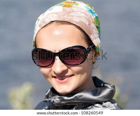 Close-up portrait of beautiful girl in the sunglasses