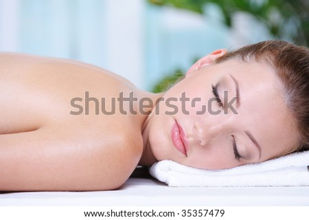 Close-up portrait of beautiful girl relaxing in the spa salon - stock photo