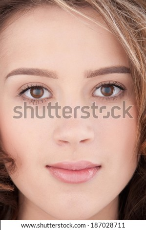 Close-up portrait of beautiful girl with clear skin and makeup
