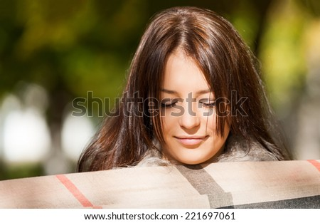 close-up portrait of beautiful girl with scarf - stock photo