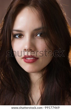 Close-up portrait of beautiful girl with trendy makeup - stock photo