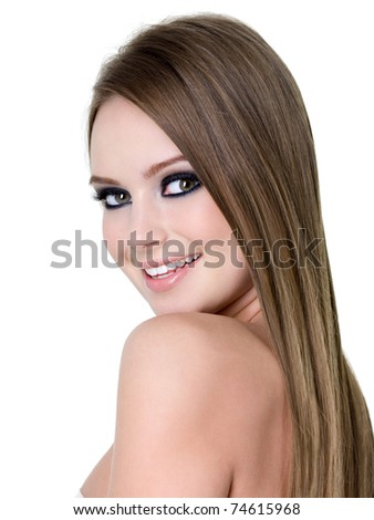 Close-up portrait of beautiful happy girl with bright eye make-up - white background