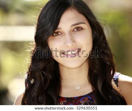 Close-up portrait of beautiful hispanic young girl - stock photo