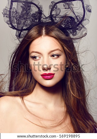 Close-up portrait of beautiful model with bright lips. on grey background fashion party style - stock photo