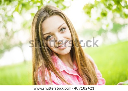 Close up portrait of beautiful sexy girls with long brown hair wearing pink stripped shirt seductively on green background. Young adult female looking at camera. Copy space for inscription - stock photo