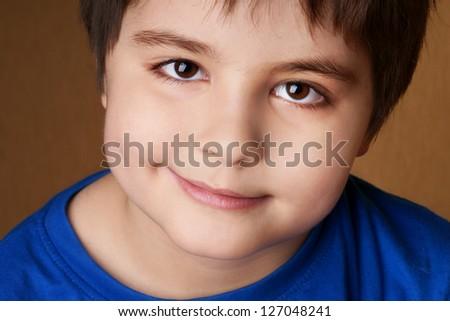 Close-up portrait of beautiful smiling little boy, studio shot - stock photo