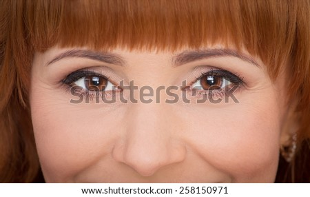 Close up portrait of beautiful smiling woman  - stock photo