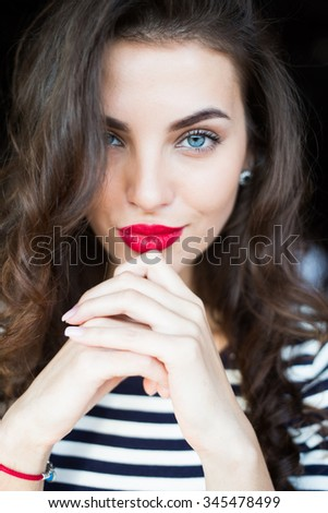 Close up portrait of beautiful smiling young woman