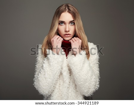 close-up portrait of beautiful winter girl in white fur. winter fashion beauty young woman - stock photo