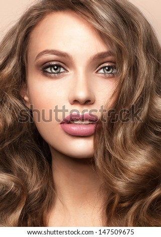 Close-up portrait of beautiful woman Fashion shiny highlighter on skin, sexy gloss lips makeup and dark eyebrows - stock photo