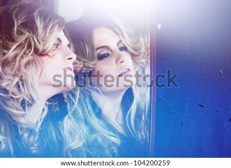 close-up portrait of beautiful woman near mirror