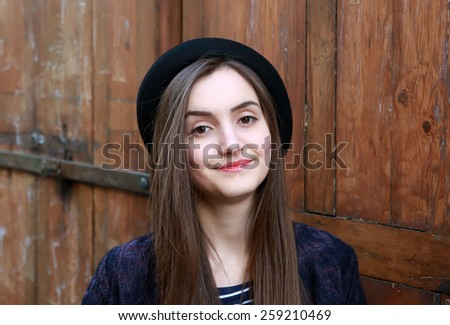 Close-up portrait of beautiful woman on vintage background  - stock photo
