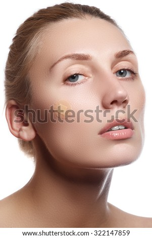 Close-up portrait of beautiful woman's purity face with bright red lips make-up. Cute model with clean shiny skin. Beautiful young woman with clear-up patches or plaster on her skin. Skin care concept - stock photo