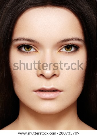 Close-up portrait of beautiful woman's purity face with fashion nude make-up, pale lips. Sexy model with clean shiny skin, purity complexion. - stock photo
