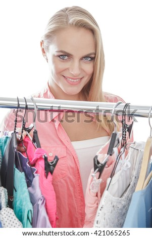 close up portrait of beautiful woman smiling while shopping clothes