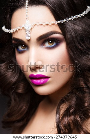 Close-up portrait of beautiful woman with bright make-up and pink lips - stock photo