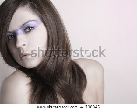 Close-up portrait of beautiful woman with professional makeup