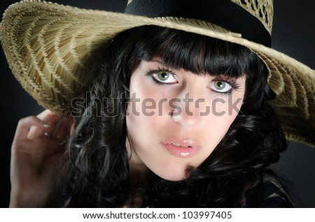 Close up portrait of beautiful woman with straw hat - stock photo
