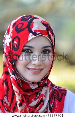 Close-up portrait of beautiful young Asian Muslim woman - stock photo