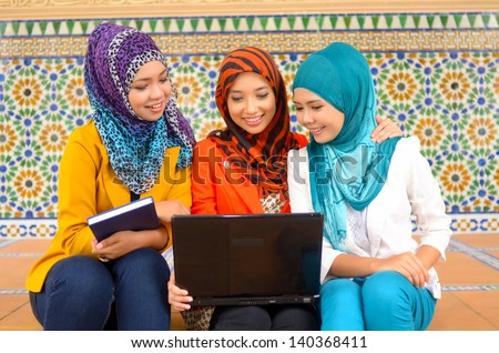 Close-up portrait of beautiful young Asian student study together - stock photo