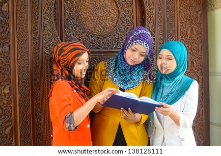 Close-up portrait of beautiful young Asian study together - stock photo