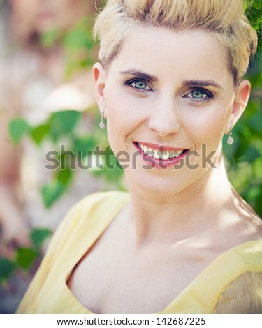 close-up portrait of beautiful young blond woman - stock photo