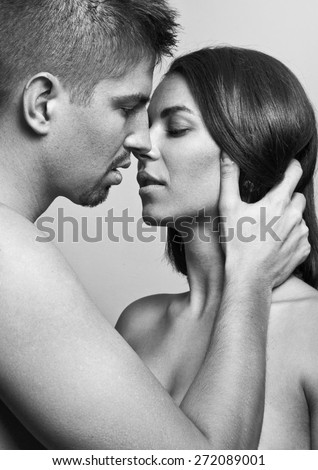 Close-up portrait of beautiful young couple posing together. - stock photo