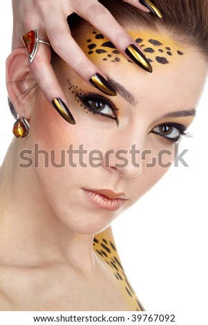 close-up portrait of beautiful young european model in cat make-up and bodyart - stock photo