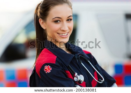 close up portrait of beautiful young female emergency medical technician - stock photo