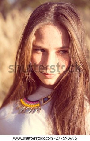 Close up portrait of beautiful young sensual woman outdoors
