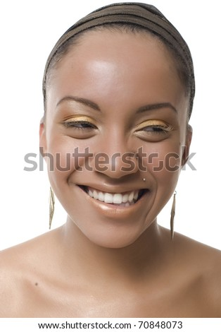 close up portrait of beautiful young smiling girl in gold dress