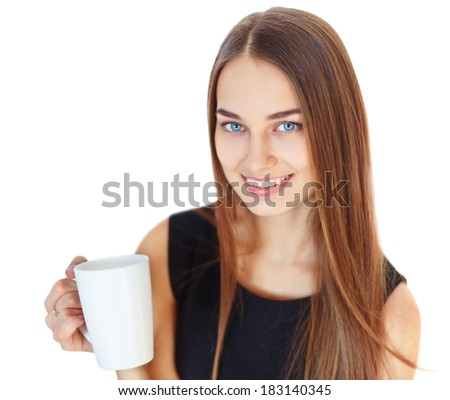 Close-up portrait of beautiful young smiling woman with long straight hair holding a cup isolated on white background