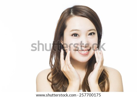 Close up portrait of beautiful young woman face. Isolated on white background. Skin care or spa concept