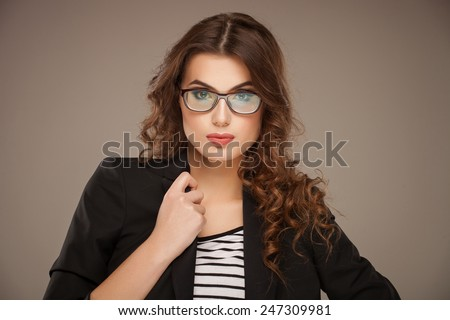 Close-up portrait of beautiful young woman in glasses - stock photo