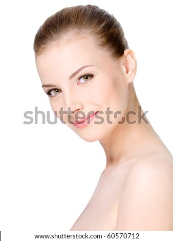 Close-up portrait of beautiful young woman's face with healthy clean skin - stock photo