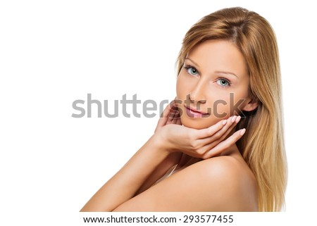 Close up portrait of beautiful young woman with blond straight long hair and natural make-up touching her face. Isolated over white background. Copy space.