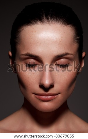 Close-up portrait of beautiful young woman with eyes closed - stock photo