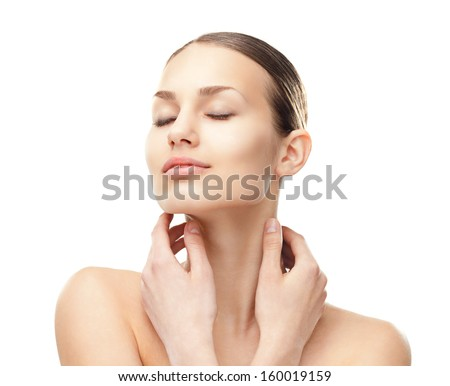Close-up portrait of beautiful young woman with eyes closed touching her face isolated on white background