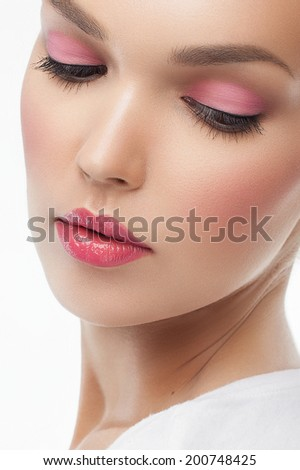 Close-up portrait of beautiful young woman with fresh pink make up and perfect skin. Trendy summer makeup - stock photo