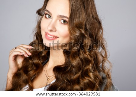 Close-up portrait of beautiful young woman with gorgeous hair and natural makeup. Fashion beauty photo - stock photo