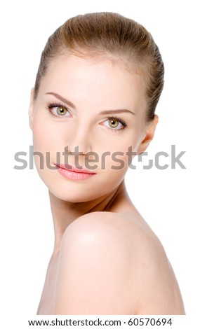 Close-up portrait of beautiful young woman with healthy clean skin on a face - isolated - stock photo