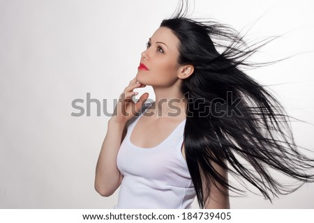 Close-up portrait of beautiful young woman with long hair. Fashion shot. Long hair concept. Studio portrait. - stock photo