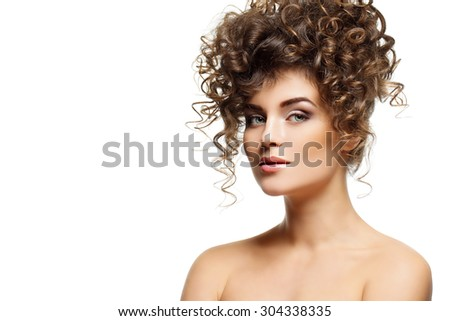 Close up portrait of beautiful young woman with make-up and dark curly hair. Isolated over white background. Copy space.