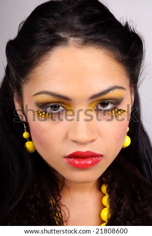 close-up portrait of beautiful young woman with theatrical make-up